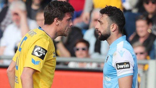 Nach dem Abpfiff des Spiels zwischen Eintracht Braunschweig und 1860 München hatte Efkan Bekiroglu (rechts) Braunschweigs Benjamin Kessel bespuckt. Jetzt droht ihm eine lange Sperre.
