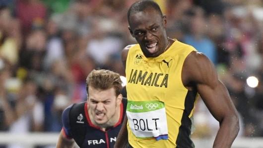 Usain Bolt (r.) ist unzufrieden trotz des 200-Meter-Siegs: Der von ihm angestrebte neue Rekord muss noch warten.