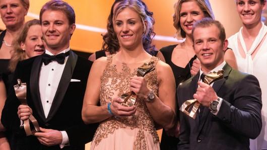Sind Sportler des Jahres: Tennis-Weltranglistenerste Angelique Kerber, flankiert von Formel I-Weltmeister Nico Rosberg (l.) und Turn-Olympiasieger Florian Hambüchen).