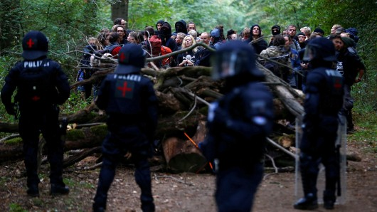 Activists are seen in the Hambacher Forst as police attempt to clear the area in Kerpen-Buir near Cologne, Germany, September 13, 2018, where protesters have built a camp with tents and treehouses to stop the clearing of the Hambach forest for a nearby open cast coal mining. REUTERS/Thilo Schmuelgen